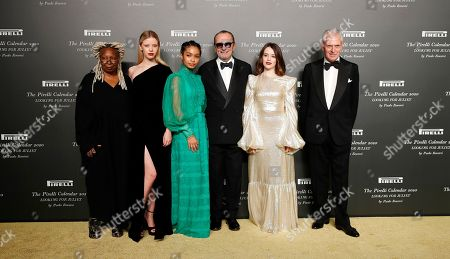 From left, American actress Whoopi Goldberg, British model Mia Goth, American model Yara Shahidi, Italian photographer Paolo Roversi, British actress Claire Foy and Pirelli CEO Marco Tronchetti Provera pose for photographers at the 2020 Pirelli Calendar event in Verona, Italy