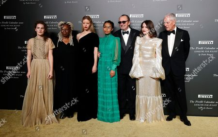 From left, Stella Roversi, American actress Whoopi Goldberg, British model Mia Goth, American model Yara Shahidi, Italian photographer Paolo Roversi, British actress Claire Foy and Pirelli CEO Marco Tronchetti Provera pose for photographers at the 2020 Pirelli Calendar event in Verona, Italy