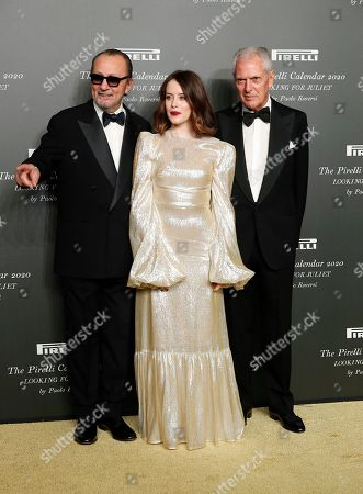 British actress Claire Foy, center, poses with Italian photographer Paolo Roversi, left, and Pirelli CEO Marco Tronchetti Provera, at the 2020 Pirelli Calendar event in Verona, Italy