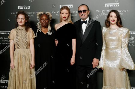 From left, Stella Roversi, American actress Whoopi Goldberg, British model Mia Goth, Italian photographer Paolo Roversi and British actress Claire Foy pose for photographers at the 2020 Pirelli Calendar event in Verona, Italy