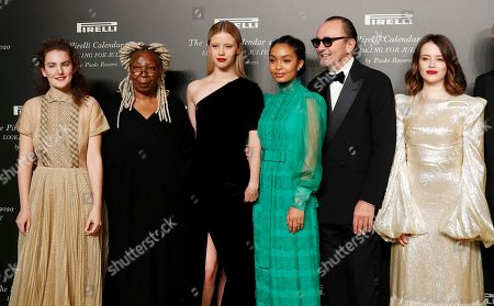 From left, Stella Roversi, American actress Whoopi Goldberg, British model Mia Goth, American model Yara Shahidi, Italian photographer Paolo Roversi and British actress Claire Foy pose for photographers at the 2020 Pirelli Calendar event in Verona, Italy