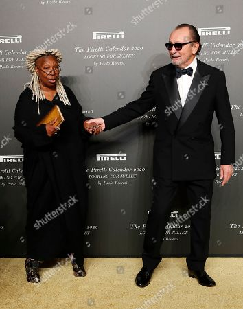 American actress Whoopi Goldberg, left, poses with Italian photographer Paolo Roversi, at the 2020 Pirelli Calendar event in Verona, Italy