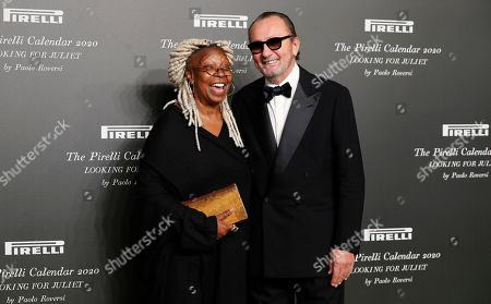 American actress Whoopi Goldberg, left, and Italian photographer Paolo Roversi pose for photographers at the 2020 Pirelli Calendar event in Verona, Italy