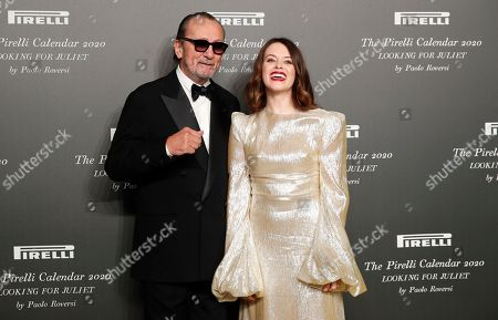 British actress Claire Foy, right, poses with Italian photographer Paolo Roversi, at the 2020 Pirelli Calendar event in Verona, Italy