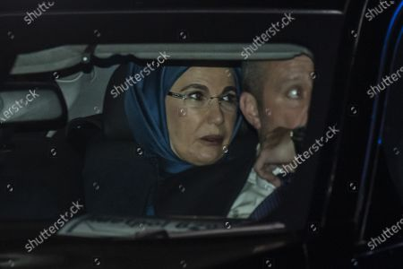 The Turkish president, Recep Tayyip Erdogan and wife Emine drive past Kurdish protestors