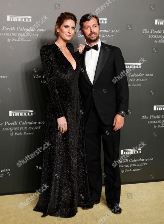 Nicole Moellhausen, left, and Giovanni Tronchetti Provera pose for photographers at the 2020 Pirelli Calendar event in Verona, Italy