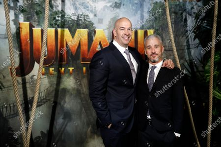 US producer and brother-in-law of Dwayne Johnson, Hiram Garcia (L) and US producer Matt Tolmach (R) pose for the media as he arrives for the world premiere of the film 'Jumanji: Next Level' at the Grand Rex theater in Paris, France, 03 December 2019. The movie will be released in France on 04 December 2019.