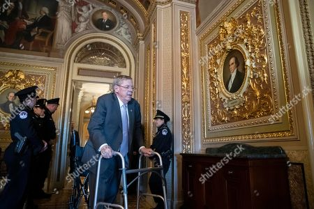 Sen. Johnny Isakson, R-Ga., walks to the Senate floor to give his farewell speech in Washington, on Capitol Hill