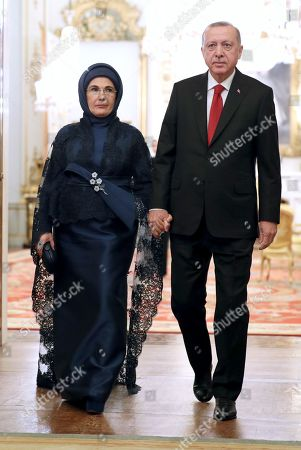 Turkish President Recep Tayyip Erdogan arrives with his wife Emine, during a reception at Buckingham Palace, as Nato leaders gather to mark 70 years of the alliance.