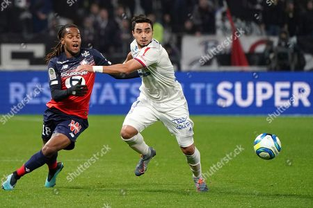 Stock Picture of Lille's Renato Luz Sanches, left, challenges for the ball with Lyon's Rafael Pereira Da Silva, right, during the French League One soccer match between Lyon and Lille in Decines, near Lyon, central France
