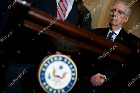 Senate Majority Leader Mitch McConnell listens during a press conference following luncheon honoring Republican Senator from Georgia Johnny Isakson in the US Capitol in Washington, DC, USA, 03 December 2019. Leader McConnell, when asked about rules for an impeachment trial, said that if he's unable to reach a deal with Senate Minority Leader Chuck Schumer then he will try to to do so with GOP votes.
