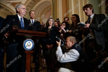 Senate Majority Leader Mitch McConnell responds to a question from the news media during a press conference following luncheon honoring Republican Senator from Georgia Johnny Isakson in the US Capitol in Washington, DC, USA, 03 December 2019. Leader McConnell, when asked about rules for an impeachment trial, said that if he's unable to reach a deal with Senate Minority Leader Chuck Schumer then he will try to to do so with GOP votes.