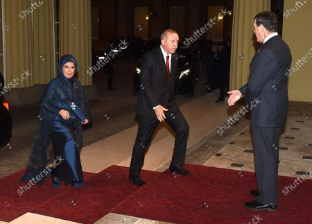 Turkish President Recep Tayyip Erdogan arrives with his wife Emine Anthony Charles Richards