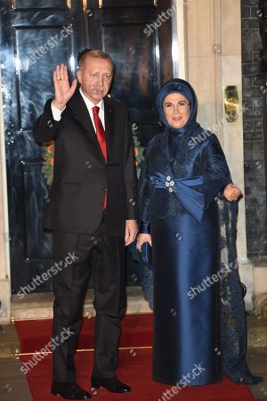 Turkish President Recep Tayyip Erdogan arrives with his wife Emine at No 10