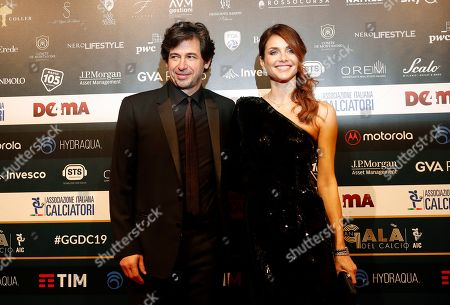 Demetrio Albertini poses with his wife Uriana Capone for photographer as they arrive for the Gran Gala' soccer awards ceremony, in Milan, Italy