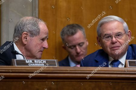 United States Senator Jim Risch (Republican of Idaho) speaks to United States Senator Bob Menendez (Democrat of New Jersey)Hill