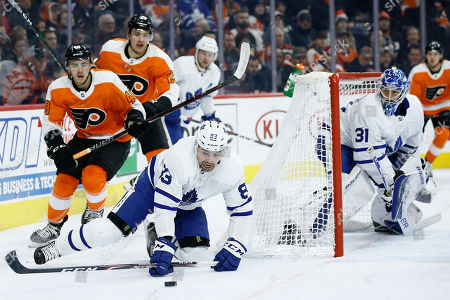 Cody Ceci, Morgan Frost, James van Riemsdyk. Toronto Maple Leafs' Cody Ceci (83) tries to clear the puck as Philadelphia Flyers' Morgan Frost (48) and James van Riemsdyk (25) pursue during the second period of an NHL hockey game, in Philadelphia