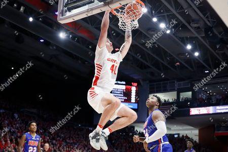 Chase Johnson, Zach Iyeyemi. Dayton's Chase Johnson (40) dunks over Houston Baptist's Zach Iyeyemi (34) during the first half of an NCAA college basketball game, in Dayton, Ohio