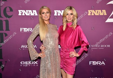 Paris Hilton, Nicky Hilton Rothschild. Socialites Paris Hilton, left, and Nicky Hilton Rothschild attend the 2019 Footwear News Achievement Awards at the IAC Building, in New York