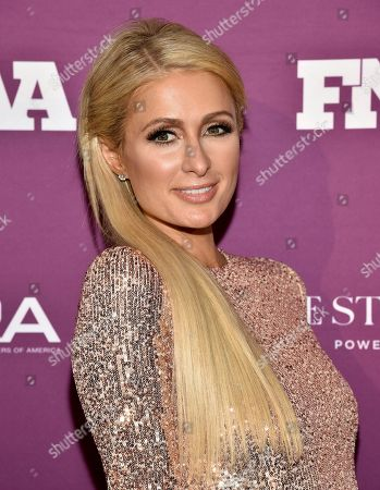 Socialite Paris Hilton attends the 2019 Footwear News Achievement Awards at the IAC Building, in New York