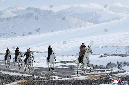 "This undated photo provided, by the North Korean government shows North Korean leader Kim Jong Un, right, and his wife Ri Sol Ju, second from right, riding on white horse during a visit to Mount Paektu, North Korea. North Korea says leader Kim has taken a second ride on a white horse to a sacred mountain in less than two months. Independent journalists were not given access to cover the event depicted in this image distributed by the North Korean government. The content of this image is as provided and cannot be independently verified. Korean language watermark on image as provided by source reads: ""KCNA"" which is the abbreviation for Korean Central News Agency"