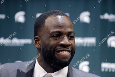 Former Michigan State and current Golden State Warriors player Draymond Green talks to reporters before an NCAA college basketball, in East Lansing, Mich