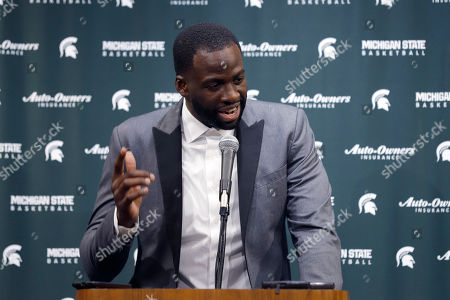 Stock Image of Former Michigan State and current Golden State Warriors player Draymond Green talks to reporters before an NCAA college basketball game between Michigan State and Duke, in East Lansing, Mich
