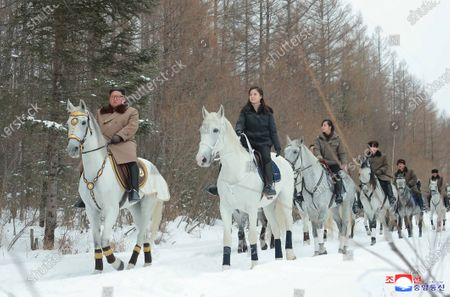 A photo released by the official North Korean Central News Agency (KCNA) on 03 December 2019 shows (L-R) North Korean leader Kim Jong-un, his wife Ri Sol-ju, and his sister Kim Yo-jong during a horseback ride through a snow-covered scenery at an unspecified location in North Korea.