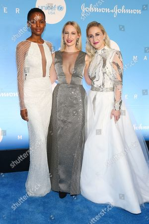 Flaviana Matata, Emily Burnett, Sterling McDavid. Flaviana Matata, from left, Emily Burnett and Sterling McDavid attend the 15th annual UNICEF Snowflake Ball at The Atrium, in New York