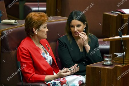 Stock Image of Senator Jacqui Lambie (R) and One Nation Senator Pauline Hanson (L) speak during a debate in the Senate chamber at Parliament House in Canberra, Australia, 04 December 2019. A medical evacuation law, the Medevac Bill, which passed last year, has been repealed by the government with the help of Senator Jacqui Lambie. The Medevac Bill provided critically sick refugees and asylum seekers, which are being held in offshore detention centers, access to health healthcare facilities in Australia.