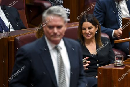 Stock Photo of Senator Jacqui Lambie (R) and One Nation Senator Pauline Hanson (not seen) speak during a debate in the Senate chamber at Parliament House in Canberra, Australia, 04 December 2019. A medical evacuation law, the Medevac Bill, which passed last year, has been repealed by the government with the help of Senator Jacqui Lambie. The Medevac Bill provided critically sick refugees and asylum seekers, which are being held in offshore detention centers, access to health healthcare facilities in Australia.
