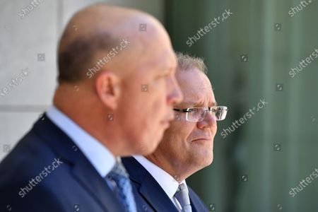 Minister for Home Affairs Peter Dutton (L) and Prime Minister Scott Morrison (R) speak during a press conference at Parliament House in Canberra, Australia, 04 December 2019. The Medevac Bill provided critically sick refugees and asylum seekers, which are being held in offshore detention centers, access to health healthcare facilities in Australia.