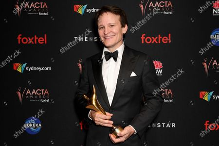 Stock Image of Damon Herriman poses for a photograph after winning the AACTA Award for Best Lead Actor at the 2019 Australian Academy of Cinema and Television Arts Awards in Sydney, Australia, 04 December 2019.