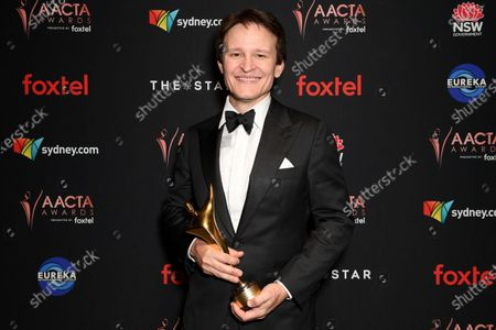 Damon Herriman poses for a photograph after winning the AACTA Award for Best Lead Actor at the 2019 Australian Academy of Cinema and Television Arts Awards in Sydney, Australia, 04 December 2019.
