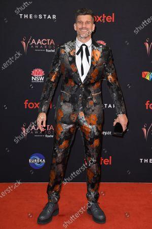 Australian television presenter Osher Gunsberg arrives at the 2019 Australian Academy of Cinema and Television Arts Awards in Sydney, Australia, 04 December 2019.