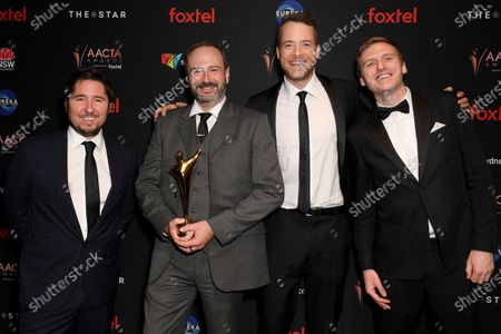 Hamish Blake (2-R) poses for a photograph with Endemol Shine producers David McDonald (2-L), Eoin Maher (R) and AJ Johnson (L) after winning the AACTA Award for Best Entertainment Program at the 2019 Australian Academy of Cinema and Television Arts Awards in Sydney, Australia, 04 December 2019.
