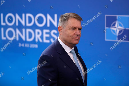 Romanian President Klaus Werner Iohannis arrives for a NATO leaders meeting at The Grove hotel and resort in Watford, Hertfordshire, England, . As NATO leaders meet and show that the world's biggest security alliance is adapting to modern threats, NATO Secretary-General Jens Stoltenberg is refusing to concede that the future of the 29-member alliance is under a cloud