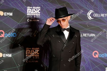 Actor Chang Chen poses for photographers upon arrival at the Asian Music Awards in Nagoya, Japan