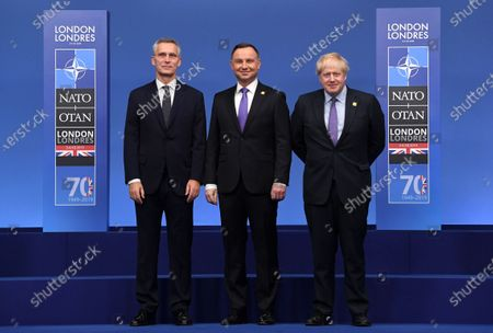 Polish President Andrzej Duda (C) poses with British Prime Minister Boris Johnson (R) and Nato Secretary General Jens Stoltenberg during the NATO Summit in London, Britain, 04 December 2019. NATO countries' heads of states and governments gather in London for a two-day meeting.