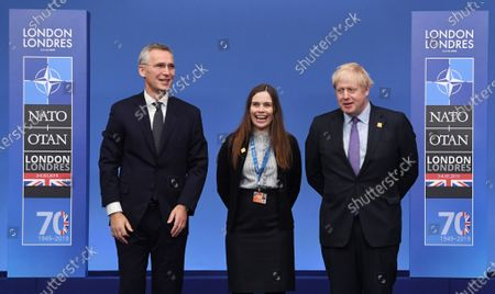 Stock Photo of Prime Minister of Iceland Katrin Jakobsdottir (C) poses with British Prime Minister Boris Johnson (R) and NATO Secretary-General Jens Stoltenberg (L) during the NATO Summit in London, Britain, 04 December 2019. NATO countries' heads of states and governments gather in London for a two-day meeting.