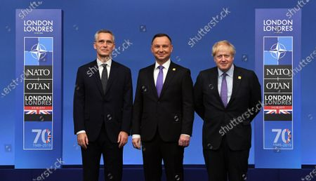 President of Poland Andrzej Duda (C) poses with British Prime Minister Boris Johnson (R) and NATO Secretary-General Jens Stoltenberg (L) during the NATO Summit in London, Britain, 04 December 2019. NATO countries' heads of states and governments gather in London for a two-day meeting.