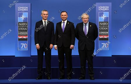 Stock Image of President of Poland Andrzej Duda (C) poses with British Prime Minister Boris Johnson (R) and NATO Secretary-General Jens Stoltenberg (L) during the NATO Summit in London, Britain, 04 December 2019. NATO countries' heads of states and governments gather in London for a two-day meeting.