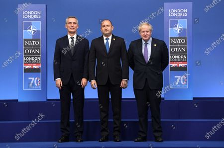 Bulgaria's President Rumen Radev (C) poses with British Prime Minister Boris Johnson (R) and Nato Secretary General Jens Stoltenberg (L) during the NATO Summit in London, Britain, 04 December 2019. NATO countries' heads of states and governments gather in London for a two-day meeting.