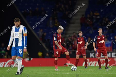 Chimy Avila of CA Osasuna with his teammates and David Lopez of RCD Espanyol after the 2-4