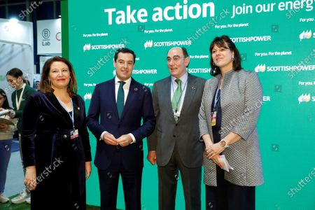 Andalusian regional President Juanma Moreno (2-L), CEO of Spanish electric company Iberdrola Jose Ignacio Galan (2-R), British Minister of State for Energy and Clean Growth Claire Perry O'Neil (R) and Andalusian regional Minister of Agriculture, Fisheries and Sustainable Development Carmen Crespo (L) pose for a photograph before the start of the 'Green Revolution. An Action Commitment for Climate from Andalucia' event, held within the UN Climate Change Conference COP25 in Madrid, Spain, 04 December 2019. The UN Climate Change Conference COP25 runs from 02 to 13 December 2019.