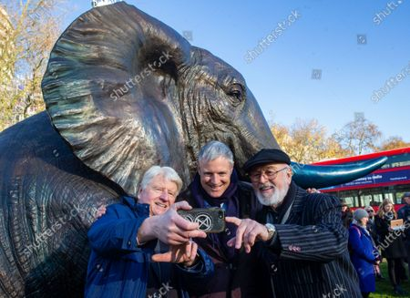 Stock Photo of Environmentalist and Author, Stanley Johnson takes a selfie with Zac Goldsmith, Minister for Environmenmt, Food and Rural Affairs with Downton Abbey actor, Peter Egan, supporting the launch. The sculptures are by Artists ,Gillie and Marc.21 Bronze Life-sized Elephants unveiled at Marble Arch to hight the plight of the species which faces extinction by 2040.