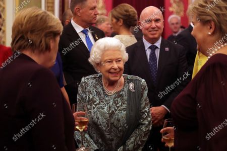 Queen Elizabeth II, with left Angela Merkel (German Chancellor) and right Erna Solberg (Prime Minister, Norway). Behind Her Majesty (left) Klaus Iohannis (President, Romania)