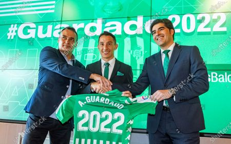 Stock Photo of Real Betis' midfielder Andres Guardado (C) poses for photographers with Betis' president Angel Haro (R) and Betis' sports director Alexis Trujillo (L) after signing a new contract with the Spanish La Liga soccer club in Seville, Spain, 04 December 2019. Mexican midfielder Andres Guardado signed a new contract with Real Betis until 2022.