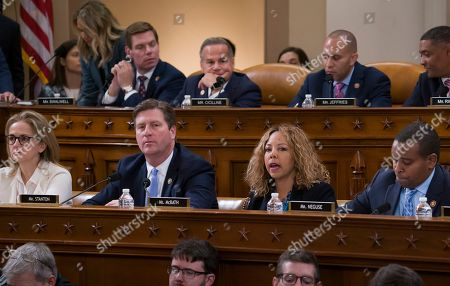 Madeleine Dean, Greg Stanton, Lucy McBath, Joe Neguse. From front left, Rep. Madeleine Dean, D-Pa., Rep. Greg Stanton, D-Ariz., Rep. Lucy McBath, D-Ga., and Rep. Joe Neguse, D-Colo., respond during a roll call vote as the House Judiciary Committee holds a hearing on the constitutional grounds for the impeachment of President Donald Trump, on Capitol Hill in Washington