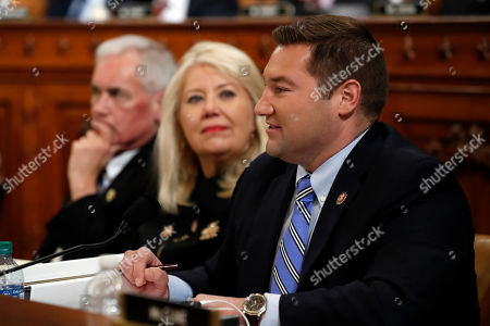 Rep. Guy Reschenthaler, R-Pa., right, questions constitutional law experts during a hearing before the House Judiciary Committee on the constitutional grounds for the impeachment of President Donald Trump, on Capitol Hill in Washington. At center is Rep. Debbie Lesko, R-Ariz., and left is Rep. Tom McClintock, R-Calif